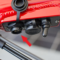 The relay board on the Optibike, the arrow points to the charge connector